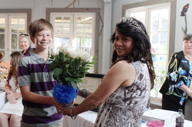 Stephanie Hoppmeyer receiving flowers from her son.