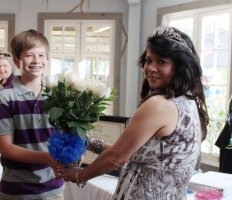 Stephanie Hoppmeyer receiving flowers from her son.